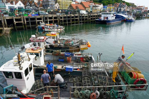 Fishermen work on routine maintenance in the harbour in Scarborough UK on Tuesday June 2 2020 The threat of a nodeal Brexit is back and with it the...