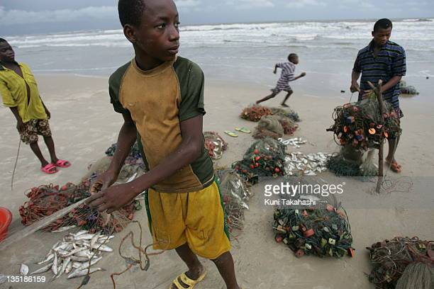 Fishermen work on the beach October 13 2005 in the fishing village of Itak Abasi in the Niger Delta Nigeria The delta is an oilrich region and has...