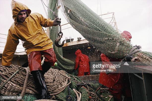 Fishermen working on trawler