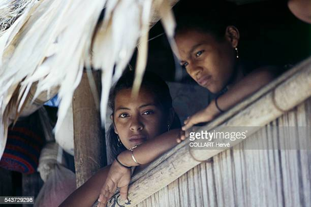 Fishermens' daughters peer out of their home