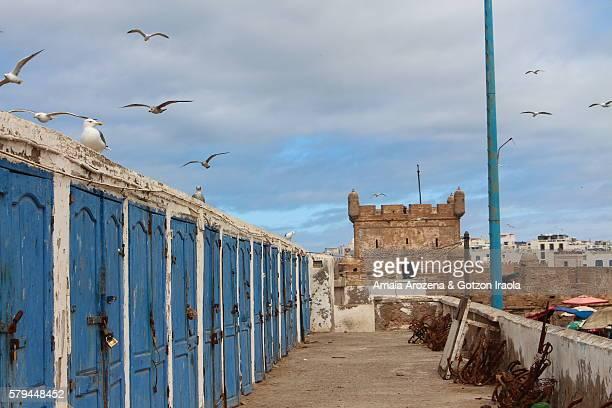 Fishermen's huts and Genoese-built citadel in Essaouira harbour, on Atlantic coast of Morocco