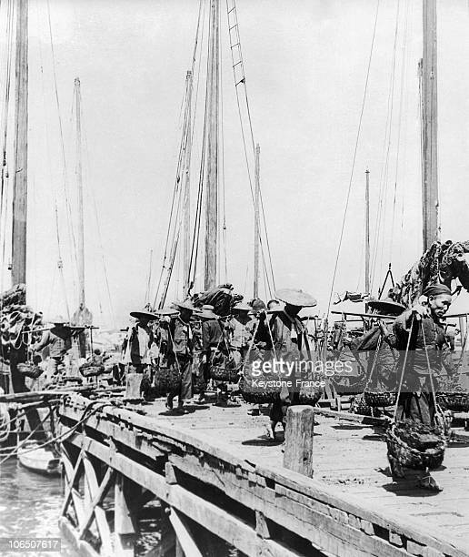 Fishers Coming Back With Fish In The Harbor Of Hong Kong At The Beginning Of The 30'S