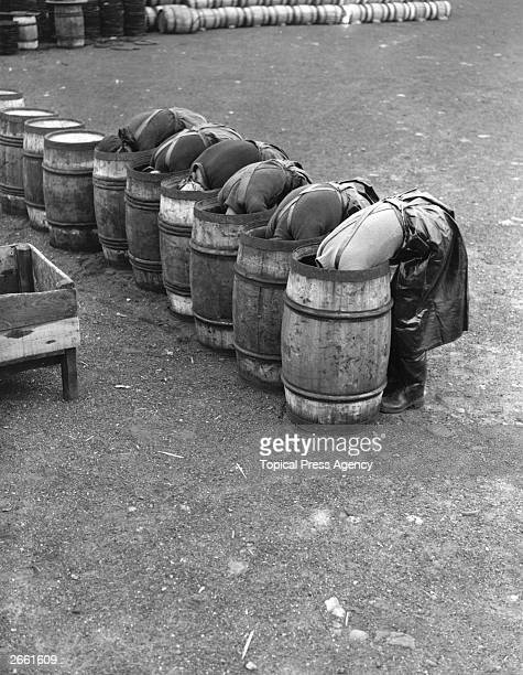 Fisherwomen laying barrels with salt in preparation for herring curing