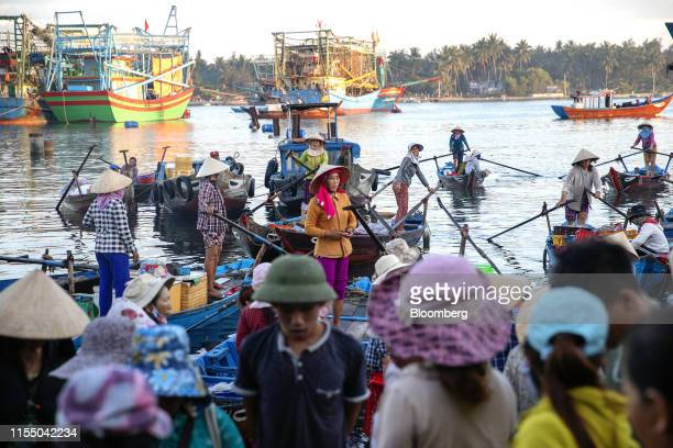 Fisherwomen stand in their boats near Tan Quang market in Quang Nam province Vietnam on Thursday June 27 2019 Fishermen are on the front lines of...