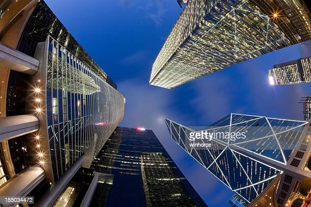 fisheye camera angle of hong kong skyscrapers at night - cheung kong centre stock pictures, royalty-free photos & images