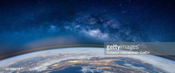 fish-eye lens view of earth against star field - planet earth stock pictures, royalty-free photos & images