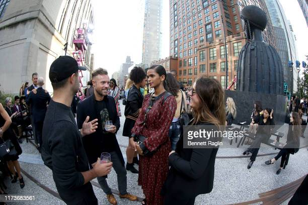 Fisheye lens view of Ramla Ali and Richard Moore attending the front row for Coach 1941 during New York Fashion Week on September 10 2019 in New York...