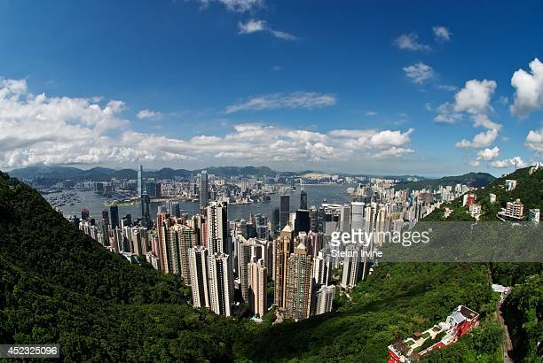 A fisheye photo of the famous view of Hong Kong from Victoria Peak with the central business district below and Victoria Harbour Kowloon and the...