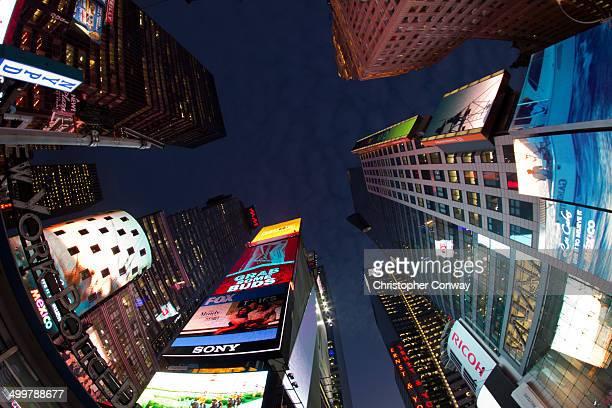 CONTENT] A fisheye shot of the skyscrapers in New Yorks Times SquareAdvertising on neon billboardsunusual anglefisheyebuildingsneonsadvertisingcity...