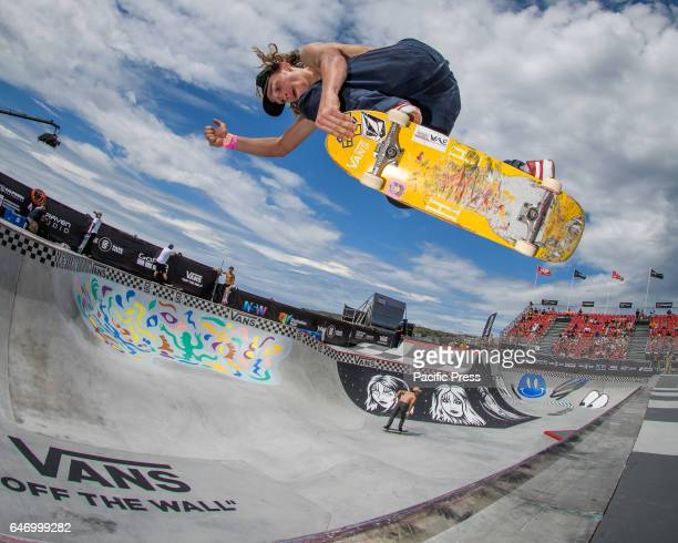 Fisheye view as skateboarders practice in the Vans Pro Bowl during the Vans Park Series terrain skateboarding world championship tour as fans watch...