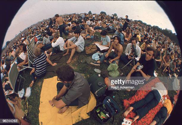 Fisheye view of a portion of the audience which includes several photographers during the Woodstock Music and Arts Fair Bethel New York August 1969...