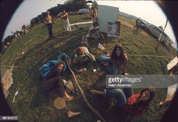 Fisheye view of festival goers as they relax on the grass near the Meher Baba tent during the Woodstock Music and Arts Fair Bethel New York August...