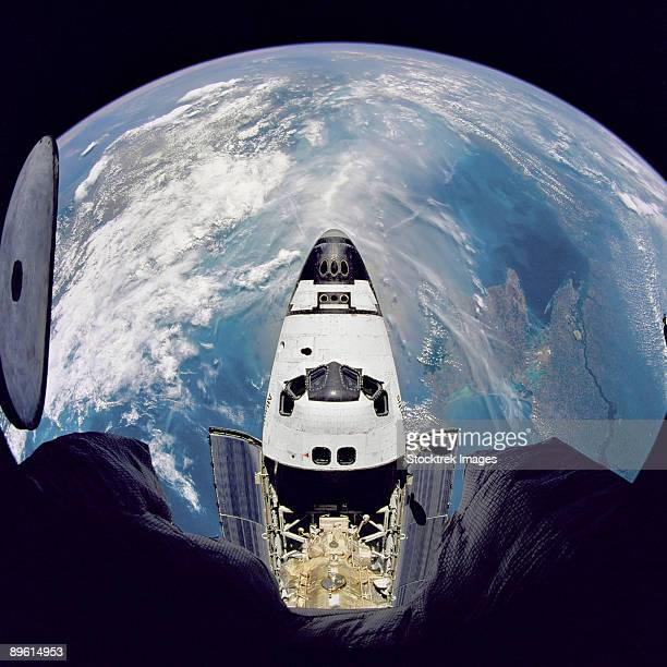 fish-eye view of the space shuttle atlantis as seen from the russian mir space station during the sts-71 mission. - space shuttle atlantis stock pictures, royalty-free photos & images