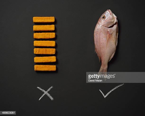 Fishfingers alongside a fresh fish