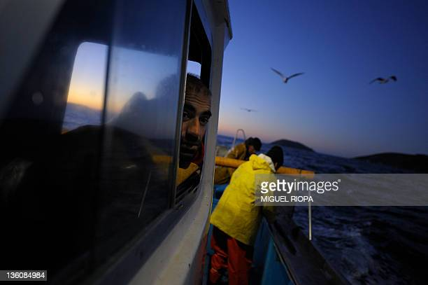 Fishierman Alfredo Budino sails his fishing boat Nanin tres to fish spider crabs on December 22 close to the Ons Islands off the cooast of Galicia...