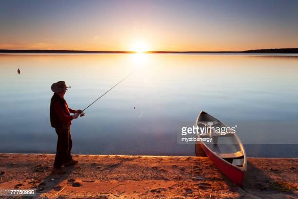 fishing at prince albert national park saskatchewan canada - saskatchewan stock pictures, royalty-free photos & images