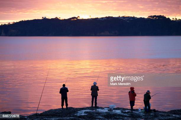 Fishing at sunset on the Waitemata Harbour