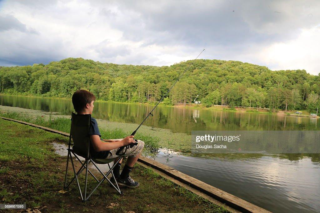 Fishing at the rural lake : Stock Photo