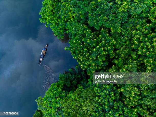 fishing before it rains -monsoon season ,kerala ,india - paisajes de india fotografías e imágenes de stock