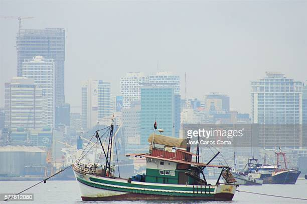 Fishing boat and Luanda's skyline