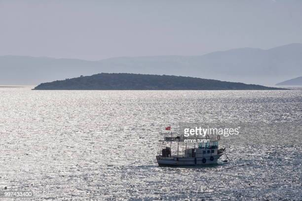 fishing boat and small island