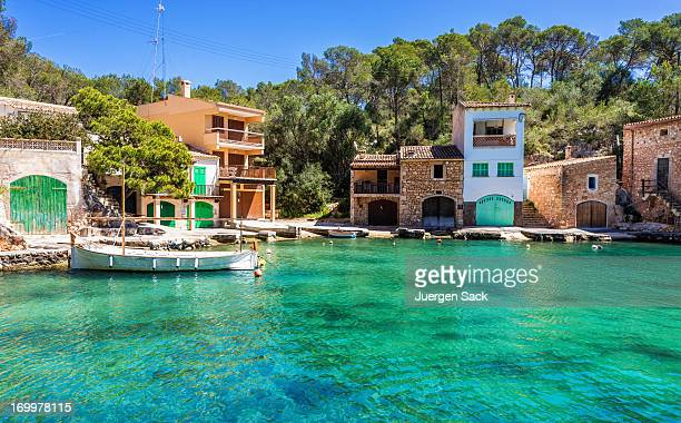 Fishing boat and traditional Majorcian houses in Cala Figuera
