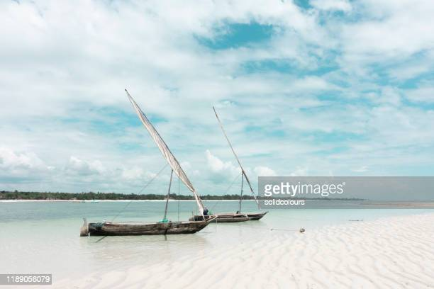 fishing boat at diani beach - mombasa stock pictures, royalty-free photos & images