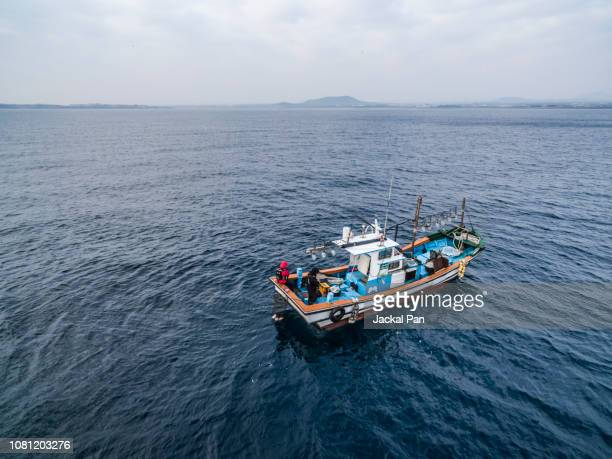 fishing boat at sea - fishing boat stock pictures, royalty-free photos & images
