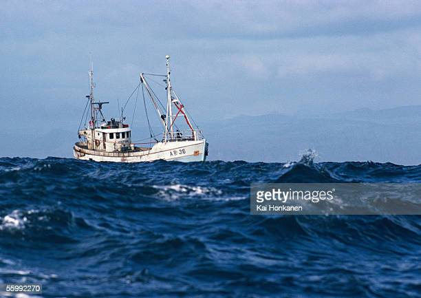 fishing boat at sea - fishing industry stock pictures, royalty-free photos & images