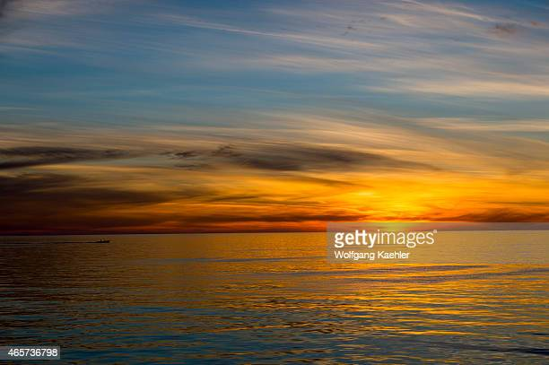 A fishing boat at sunrise with beautiful clouds at San Francisco Island in the Sea of Cortez Baja California Mexico