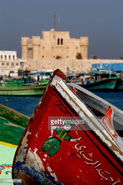Fishing boat at The Citadel of Qaitbay, a 15th-century defensive fortress located on the Mediterranean Sea coast, in Alexandria, Egypt.