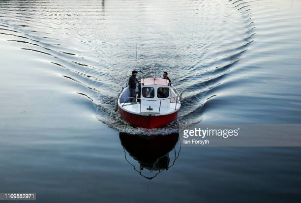 A fishing boat charter takes fishermen out of Whitby Harbour on August 24 2019 in Whitby England Temperatures are expected to climb over 30C in parts...