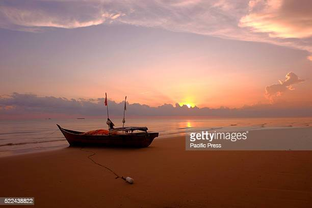A fishing boat docked on the coast of North Rupat Island This island is one of the outer islands of Indonesia with white sandy beaches Seen in front...