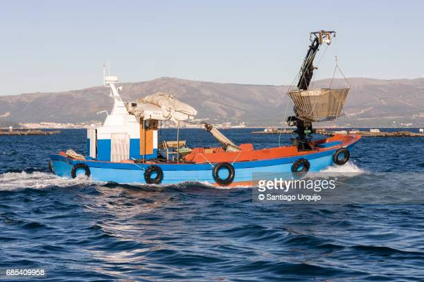 Fishing boat harvesting mussels