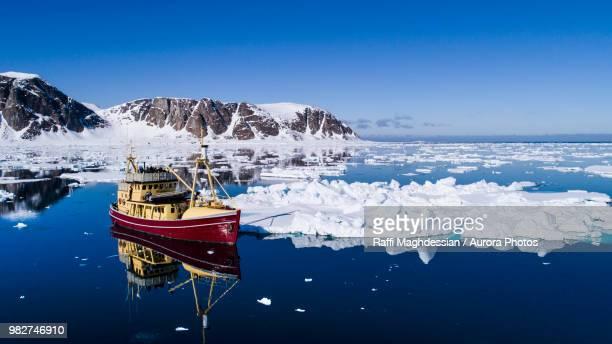 Fishing boat in Arctic Sea, Raudfjorden, Spitsbergen, Svalbard and Jan Mayen, Norway