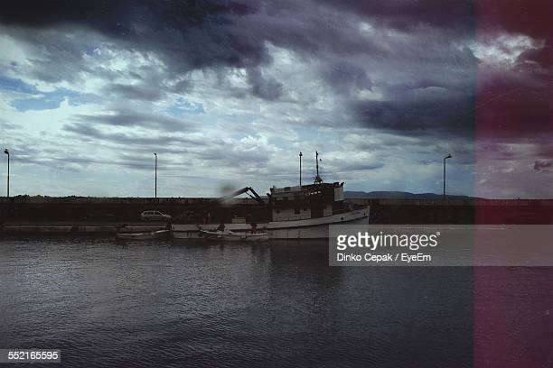 fishing boat in harbor - land vehicle stock photos and pictures