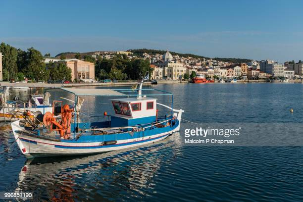 fishing boat in mytilene harbour, lesvos, greece - lesbos stock pictures, royalty-free photos & images