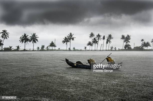 fishing boat in rain, kerala, india - kerala stock pictures, royalty-free photos & images