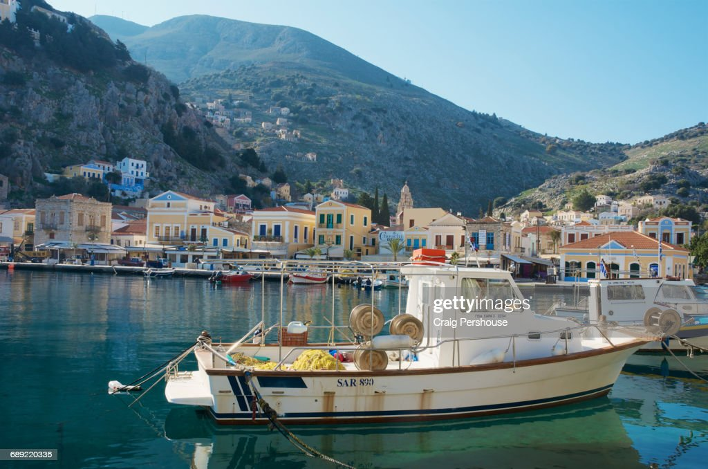 Fishing boat in Symi Harbour. : Stock Photo