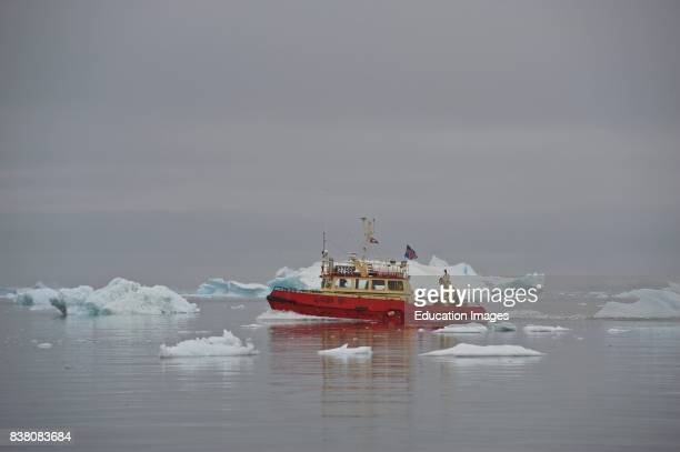A fishing boat in the Disko bay near Ilulissat Western Greenland showing of an Icelandic flag Fishing exports from Greenland accounts for about 90%...