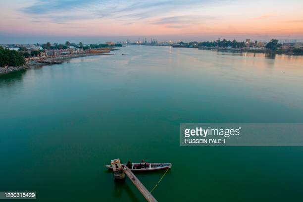 Fishing boat is moored by the bank of Shatt Al-Arab river in the southern Iraqi city of Basra, on December 27, 2020.