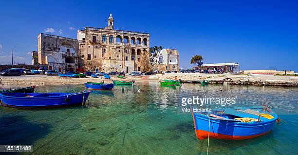 fishing boat italy - polignano a mare stock photos and pictures