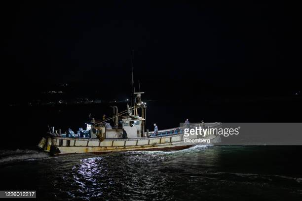 A fishing boat leaves a port at dawn on Yeonpyeong Island South Korea on Friday June 26 2020 On the sleepy island of Yeonpyeong the threat of...