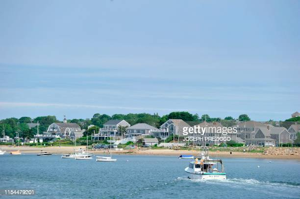 A fishing boat makes its way back to Hyannis Port Massachusets on July 7 2019