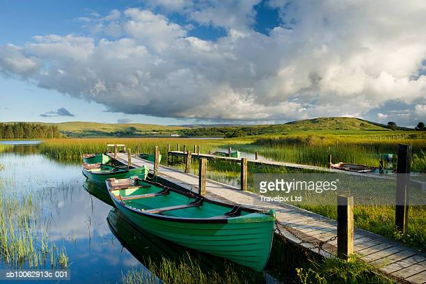 fishing boat moored at jetty - moored stock pictures, royalty-free photos & images