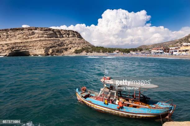 Fishing boat moored at Matala beach, Heraklion, Crete,  Greece, Mediterranean