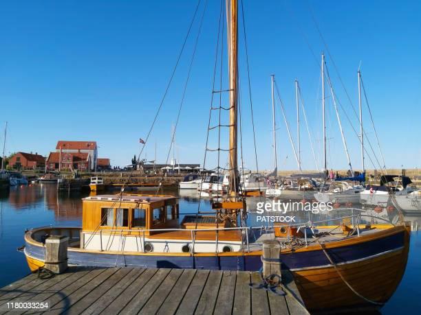 fishing boat moored in svaneke marina, bornholm island, denmark. - moored stock pictures, royalty-free photos & images