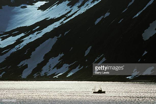Fishing boat near Honningsvag in the far north of Norway For more than a century the coastal steamer Hurtigruten has been the lifeline linking the...