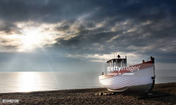 Fishing boat on a shingle beach at Dungeness.