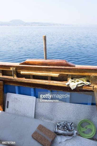 fishing boat on a tranquil day on the aegean. - emreturanphoto stock pictures, royalty-free photos & images